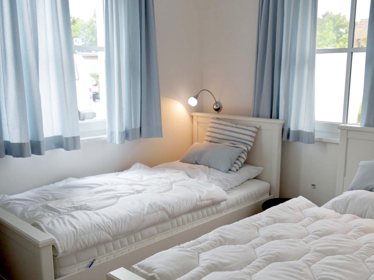 Streifenfisch – Schlafzimmer Einzelbetten